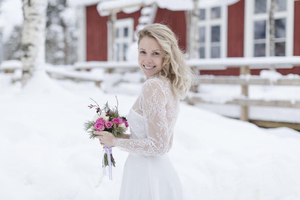 Brautkleid WInterhochzeit Schnee